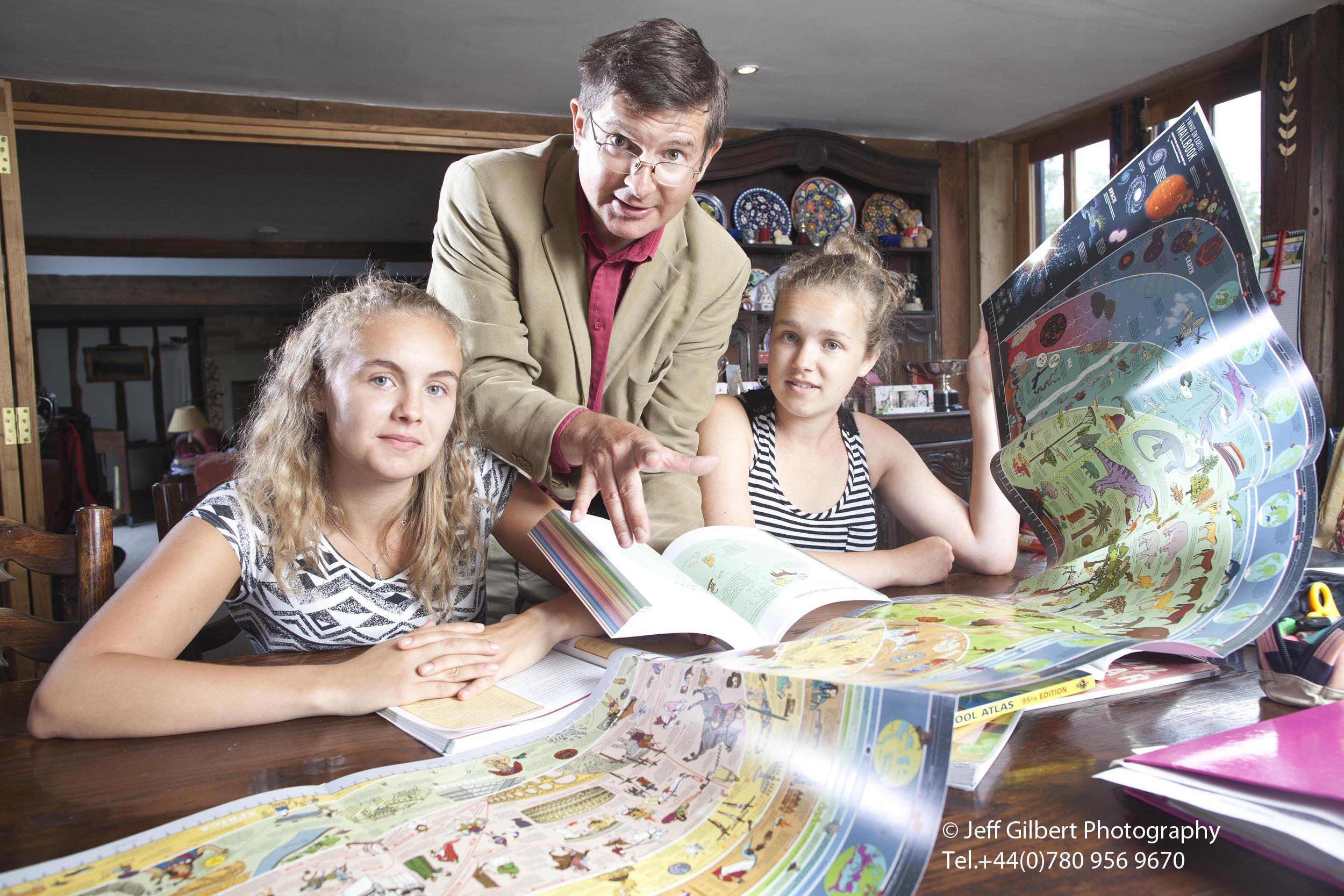 Chris LLoyd teaching his children at home in Kent